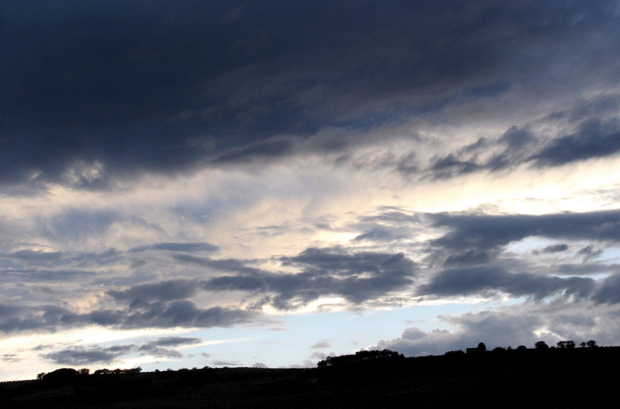Clouds catch the last glimmers of the evening light earlier this week just west of Steamboat II in Routt County.