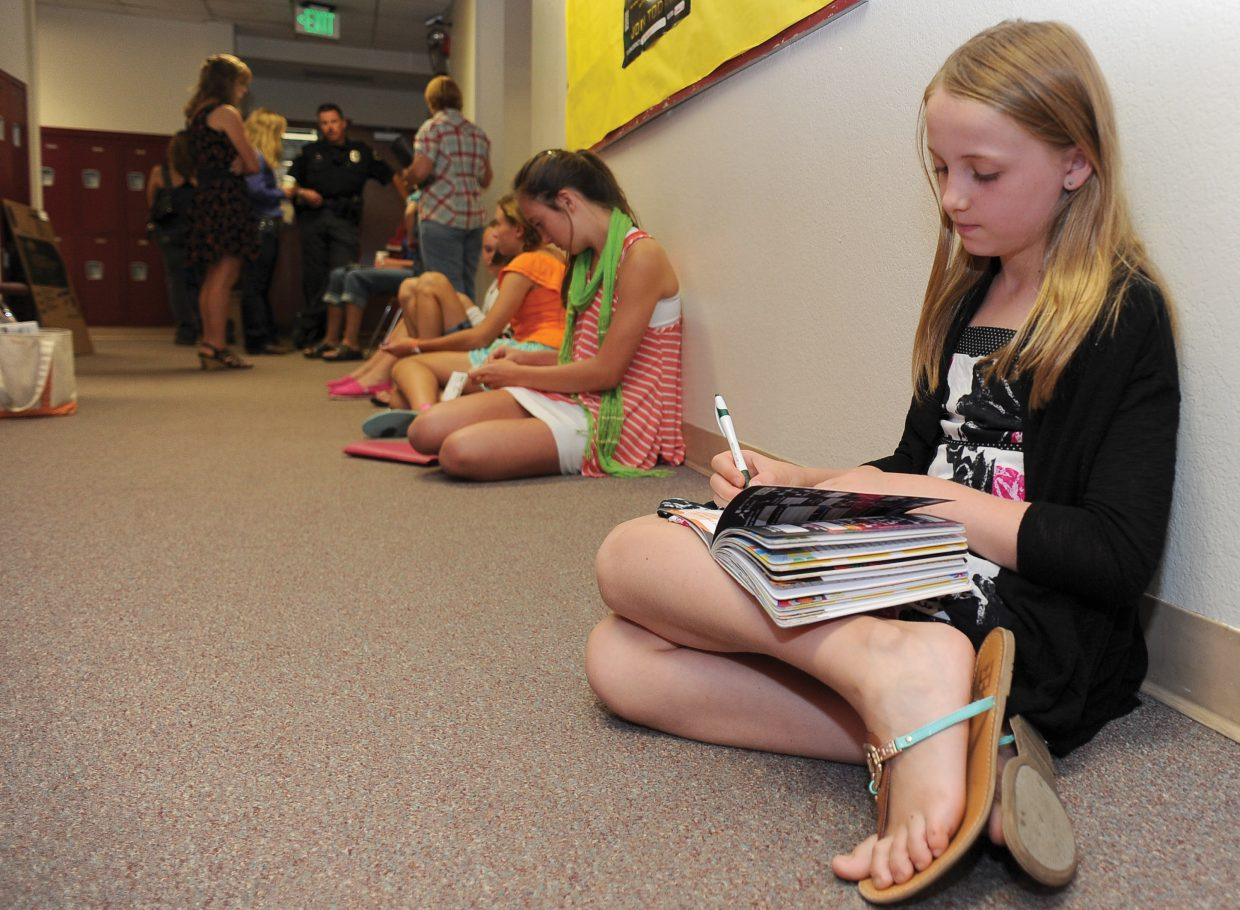 Sophia Diehl waits in a hallway at the Soroco High School on Wednesday morning for her Exhibit Day interview. Exhibit Day is a chance for the young members of 4-H to have their projects viewed and evaluated by judges before the Routt County Fair.