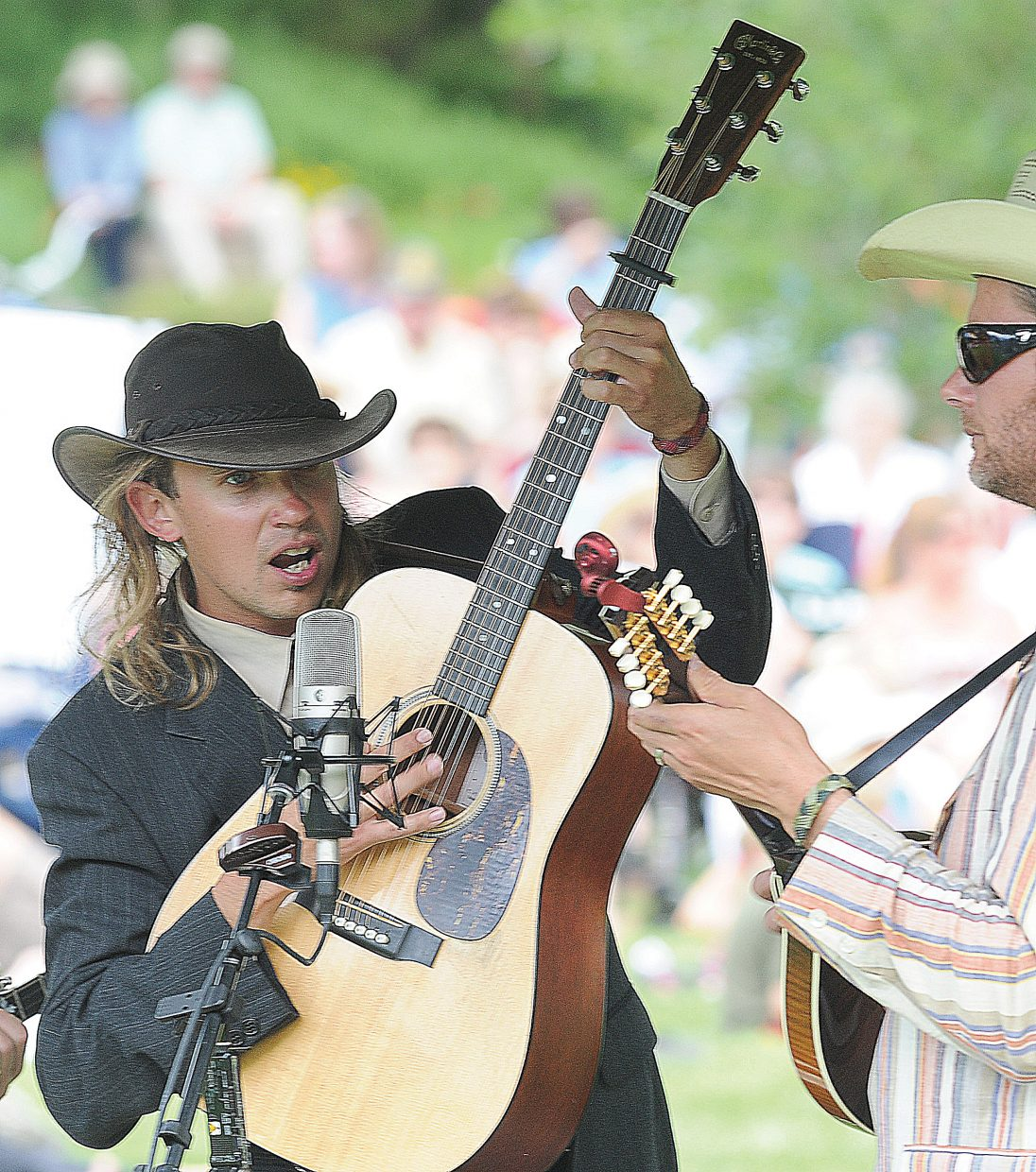 Guitarist Jay Roemer, left, jams with mandolin player Eric Baker.
