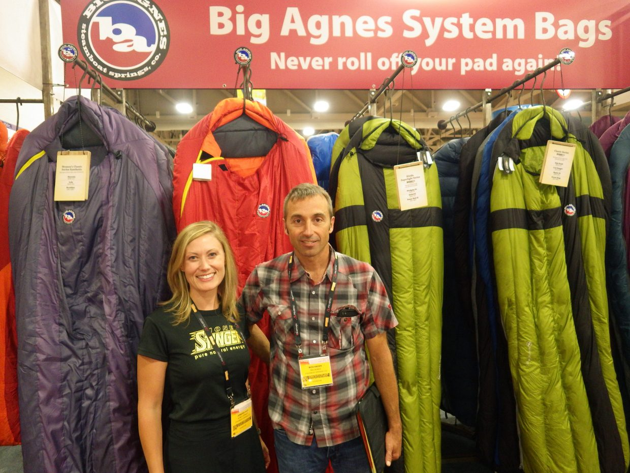 Jen Shea, left, and Rich Hager represent Honey Stinger and Big Agnes, respectively, at the Outdoor Retailer Summer Market trade show from July 31 to Aug. 3 in Salt Lake City.