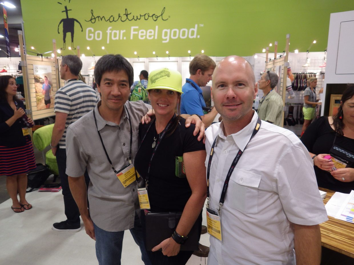 Les Wong, from left, Molly Cuffe and Steve Metcalf represent SmartWool at the Outdoor Retailer Summer Market trade show from July 31 to Aug. 3 in Salt Lake City.