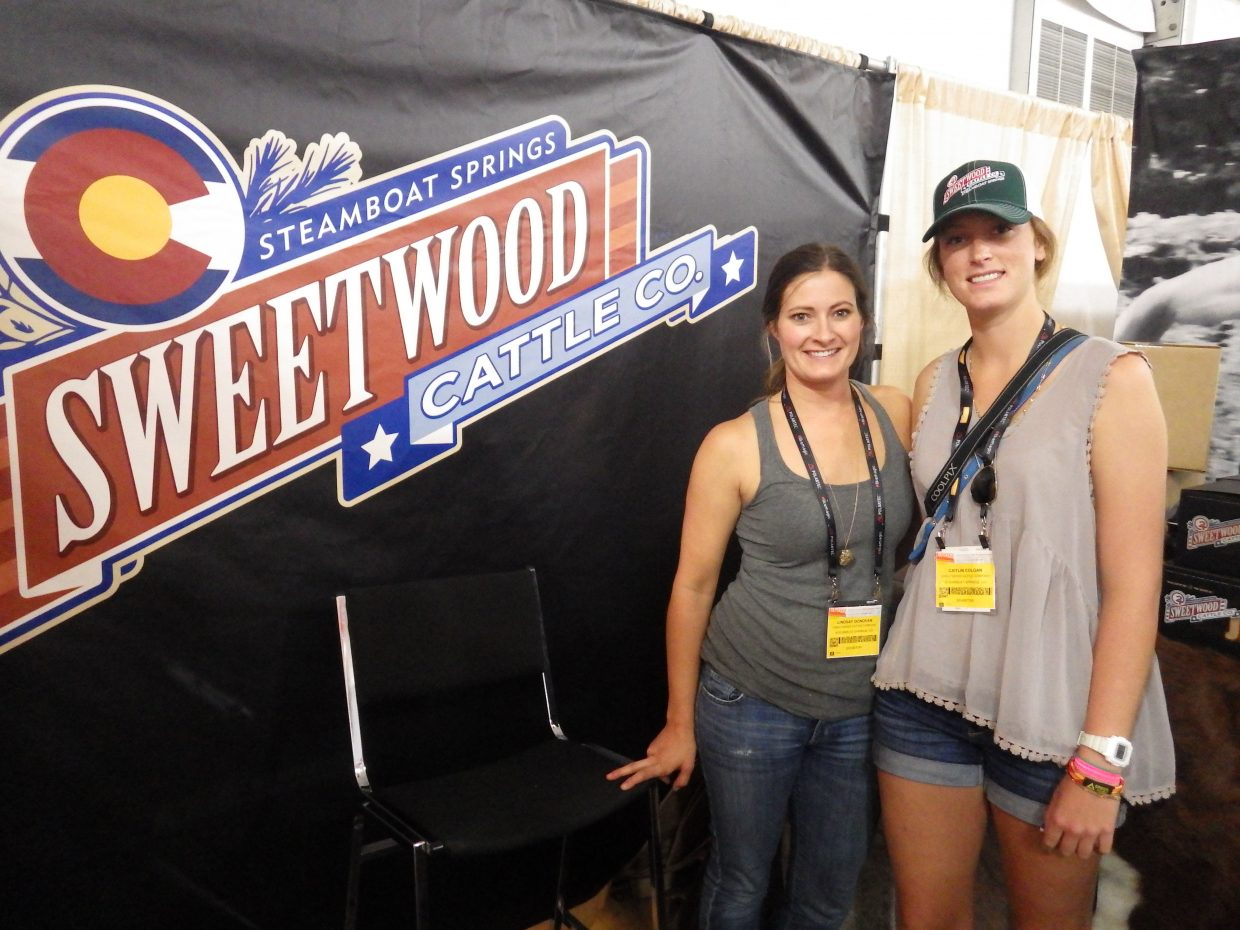 Lindsay Donovan, left, and Caitlyn Colgan represent Sweetwood Cattle Co. at the Outdoor Retailer Summer Market trade show from July 31 to Aug. 3 in Salt Lake City.