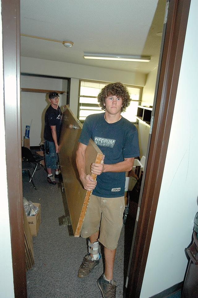 Cody Lechnir, right, and Chase Davis remove a door from one of the third-floor rooms in Monson Hall on the Colorado Mountain College campus Tuesday. The two were clearing salvageable items for a remodeling job to take place before the beginning of the 2006-07 school year. With fall enrollment up again, all the college's dorm rooms already have been assigned.