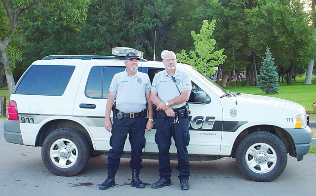 Hayden Police Chief Jody Lenahan, left, poses in front of a Sturgis, S.D., cruiser with his partner Dan Anderson at the 2003 Sturgis Motorcycle Rally.
