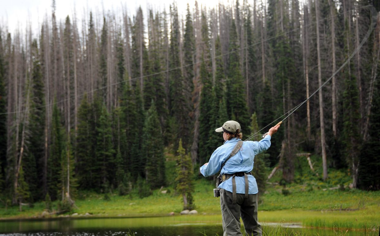 Karen Piassick casts into Whale Lake on Wednesday afternoon on Buffalo Pass. Piassick was there with fellow fishing fiends, husband, Joel Piassick, ans daughter Joan Swartz. They reported that the fishing was good.