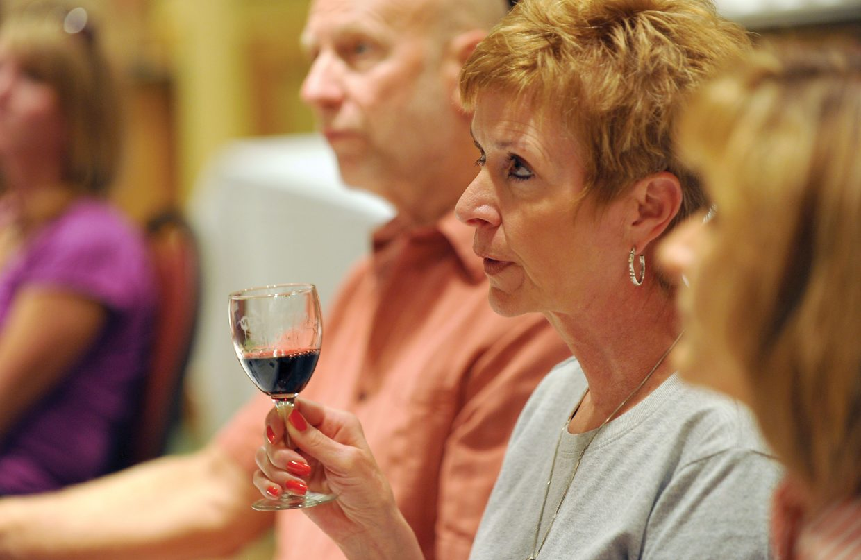 Ann Smith, of Fort Collins, listens to wine expert Kevin Hall, of Alexander Valley Vineyards, speaks about blending wines at the ninth annual Steamboat Fine Festival on Friday afternoon.