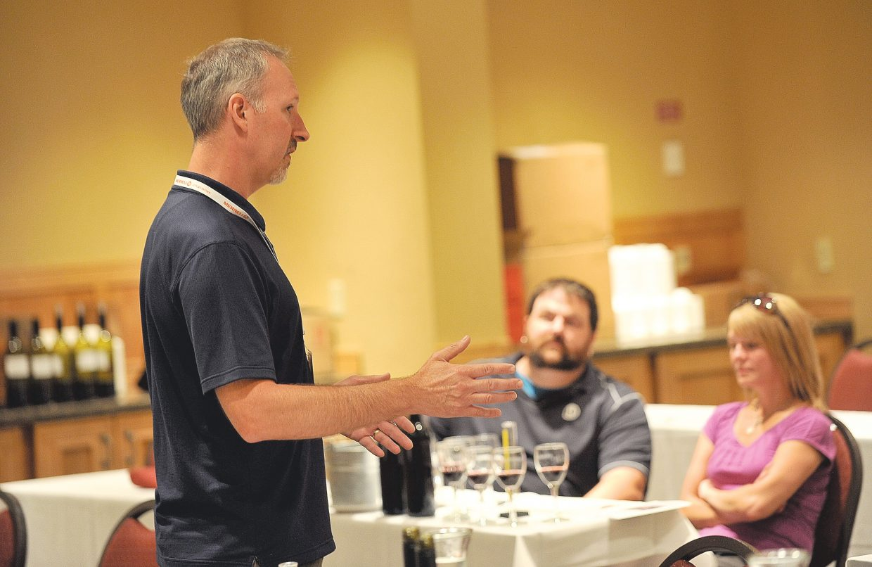 Wine expert Kevin Hall talks to participants during a blending seminar at the ninth annual Steamboat Wine Festival on Friday afternoon.