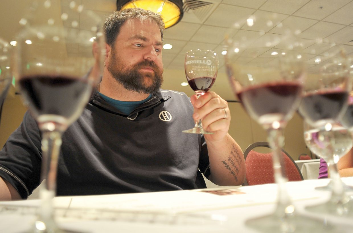 Bryan Mashinter, of Denver, checks out the wine during a blending seminar at the ninth annual Steamboat Wine Festival on Friday afternoon. The sessions were held at The Steamboat Grand with other events taking place throughout Steamboat Springs.