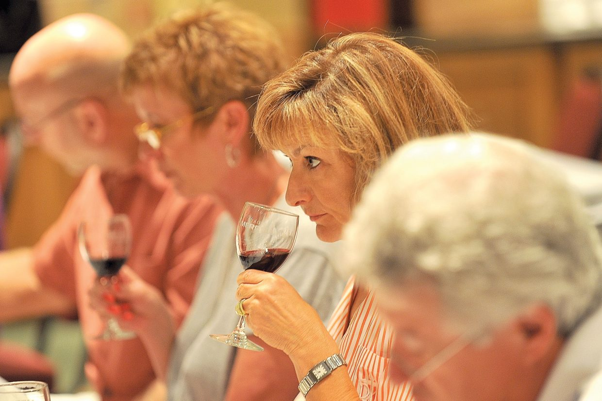 Gina Schwartz, of Fort Collins, tastes wine during a blending seminar at the ninth annual Steamboat Wine Festival on Friday afternoon. The sessions were held at The Steamboat Grand with other events taking place throughout Steamboat Springs.