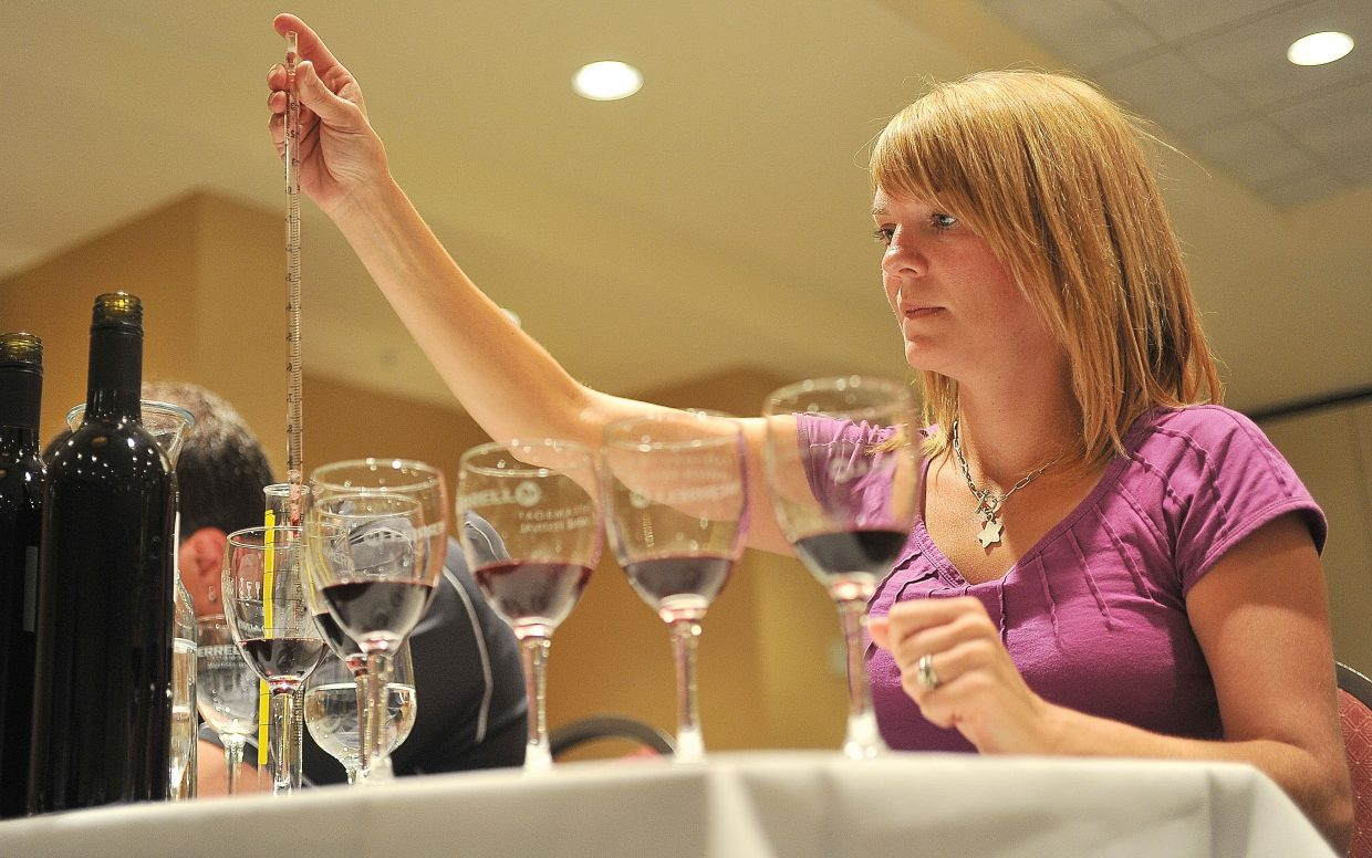 Lacey Mashinter, of Denver, blends wines during a seminar at The Steamboat Grand as part of the ninth annual Steamboat Wine Festival on Friday afternoon.