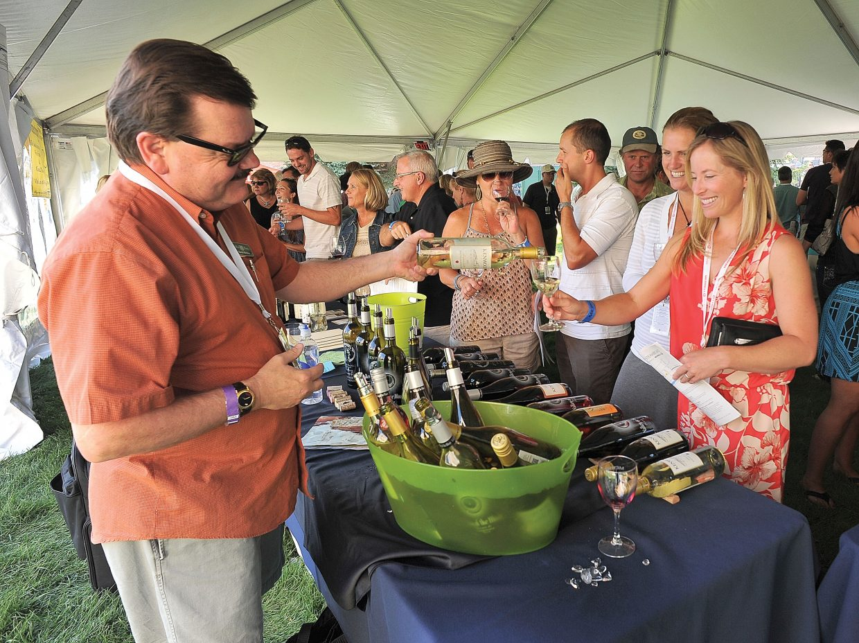 David Walden, district manager for Heck Estates, pours a glass of wine for Erin Dickerson during the annual Wine Festival tasting in downtown Steamboat Springs on Friday afternoon.