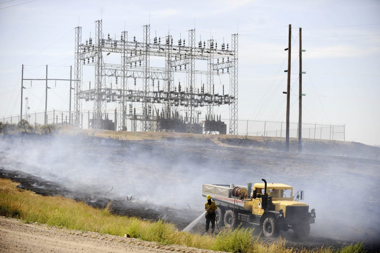 West Routt Fire Protection District firefighters work a wildfire Friday afternoon near the Hayden Station power plant.