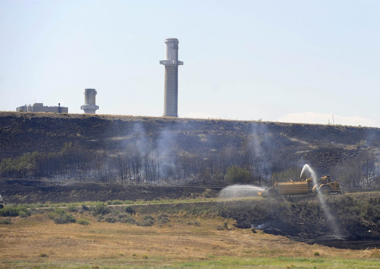Water is sprayed on a wildfire Friday near the Hayden Station power plant.