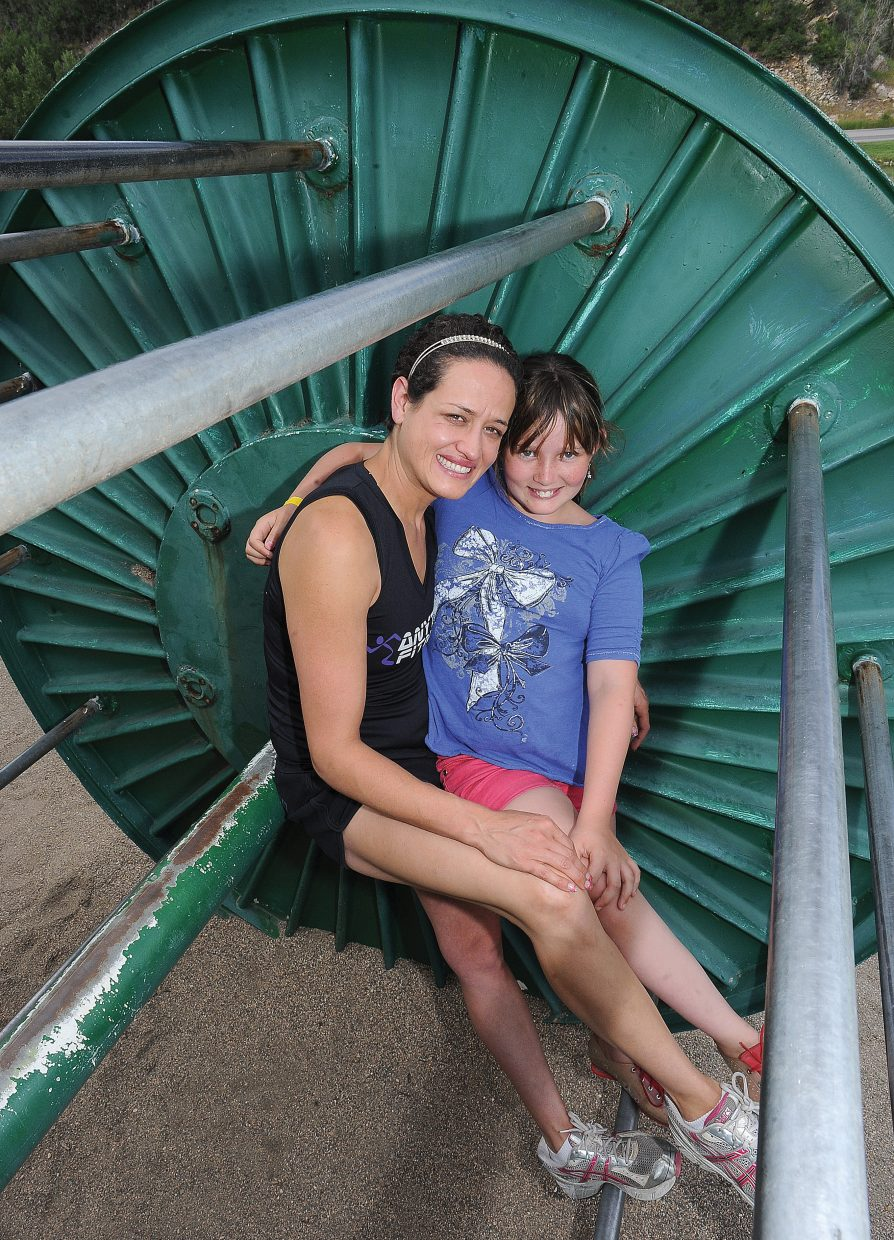 Brady Worster and her daughter Mariam hang out on the playground equipment at West Lincoln Park.