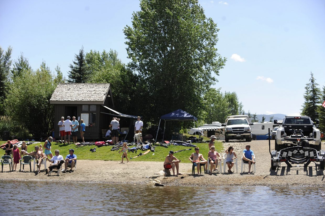 Spectators sit on the beach Saturday at Bald Eagle Lake. The event featured some of the top water skiers from Colorado and surrounding states.