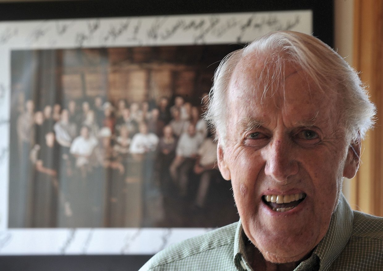 Sven Wiik poses in front of a portrait featuring all of Steamboat Springs' Olympians at his home in the Blacktail neighborhood. Wiik recalls his experiences at the 1948 London Olympics, where he was part of a demonstration team for gymnastics.
