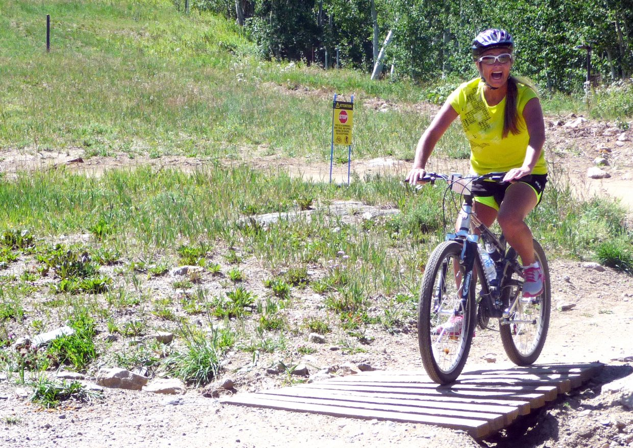 Helene Wiese, of Golden, rides the Tenderfoot downhill bike trail at Steamboat Ski Area on Saturday during a wine and biking seminar as a part of the Steamboat Wine Festival.