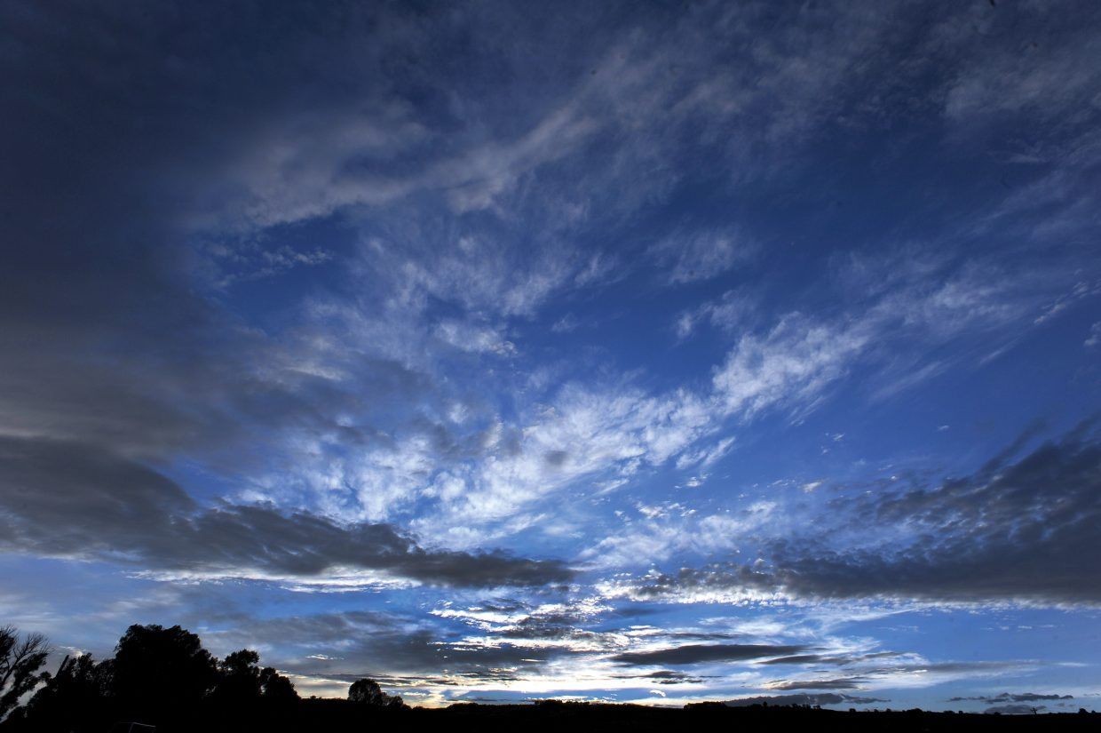 Dramatic clouds drift across the Yampa Valley Sky Sunday evening near Steamboat Springs.