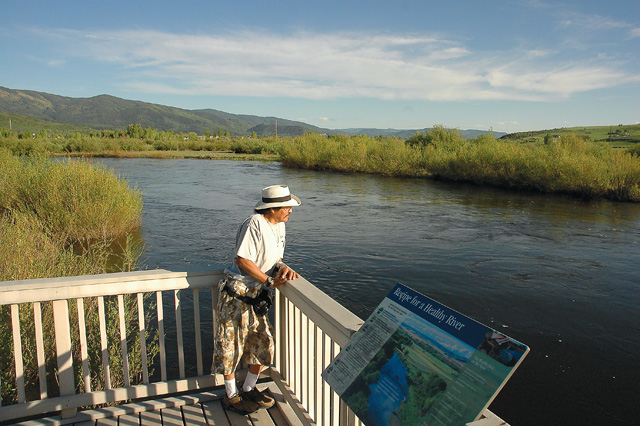 Anthony Delgartio visits the Boardwalk at Rotary Park, a 1,300-foot-long boardwalk that winds through 7 acres of wetlands near a stretch of the Yampa River east of Steamboat Springs. The park features informational signs in English and Spanish and a kiosk to educate visitors about the river and its wetlands.