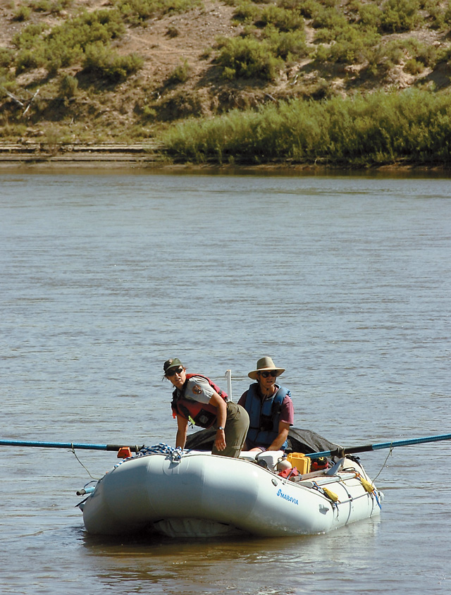 National Park Service botanist Tamara Naumann and her husband, Pete Williams, set out down the Yampa River in Dinosaur National Monument. Naumann is on a mission to eradicate the invasive plant tamarisk from the river environment, where it aggressively displaces native species.