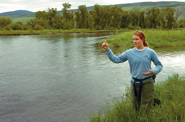 Heidi Mitzelfeld, an education specialist with The Nature Conservancy, explains how the Yampa River carves sediment from the banks of river on the outside of bends, where the current is fastest, and deposits silt and gravel on the inside of bends, where the current is slower. The river and the plants and animals that live along its length in Routt County are woven together, she said.