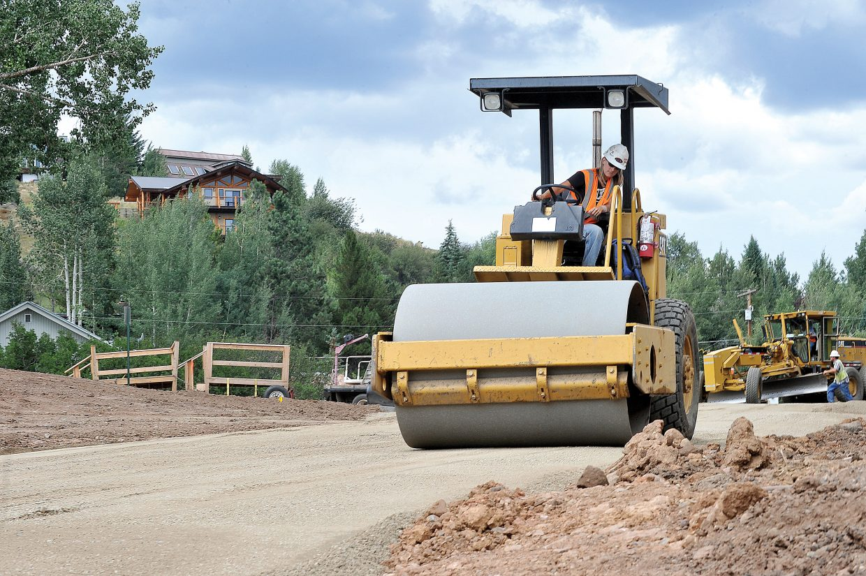Native Excavating employee Samantha Shupp uses a roller to compact soil on the new section of 12th Street in downtown Steamboat Springs.