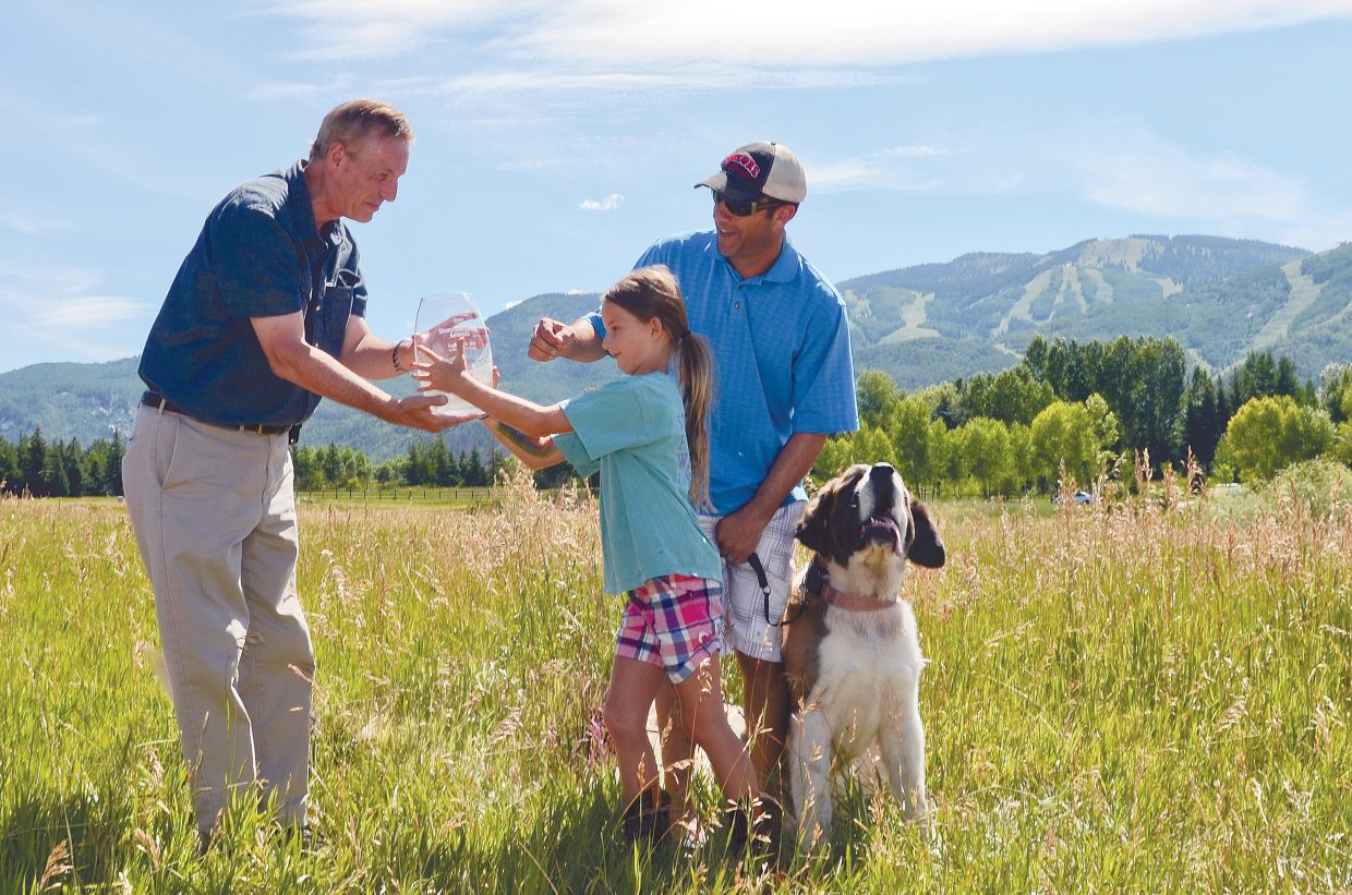 Ernie Slone, editor of Dog Fancy magazine, on Saturday presented Steamboat Springs City Council member Kenny Reisman and his daughter Macy with an award proclaiming Steamboat Springs as Dog Town USA. About 60 residents and their dogs attended the ceremony. Slone also presented Holly Larson and Molly Waters, of the Routt County Humane Society, with a check for $5,000. The annual award was given based on criteria including the presence of dog-friendly activities, restaurants, businesses, dog parks, medical specialists and pro-dog legislation, according to a release from the magazine.