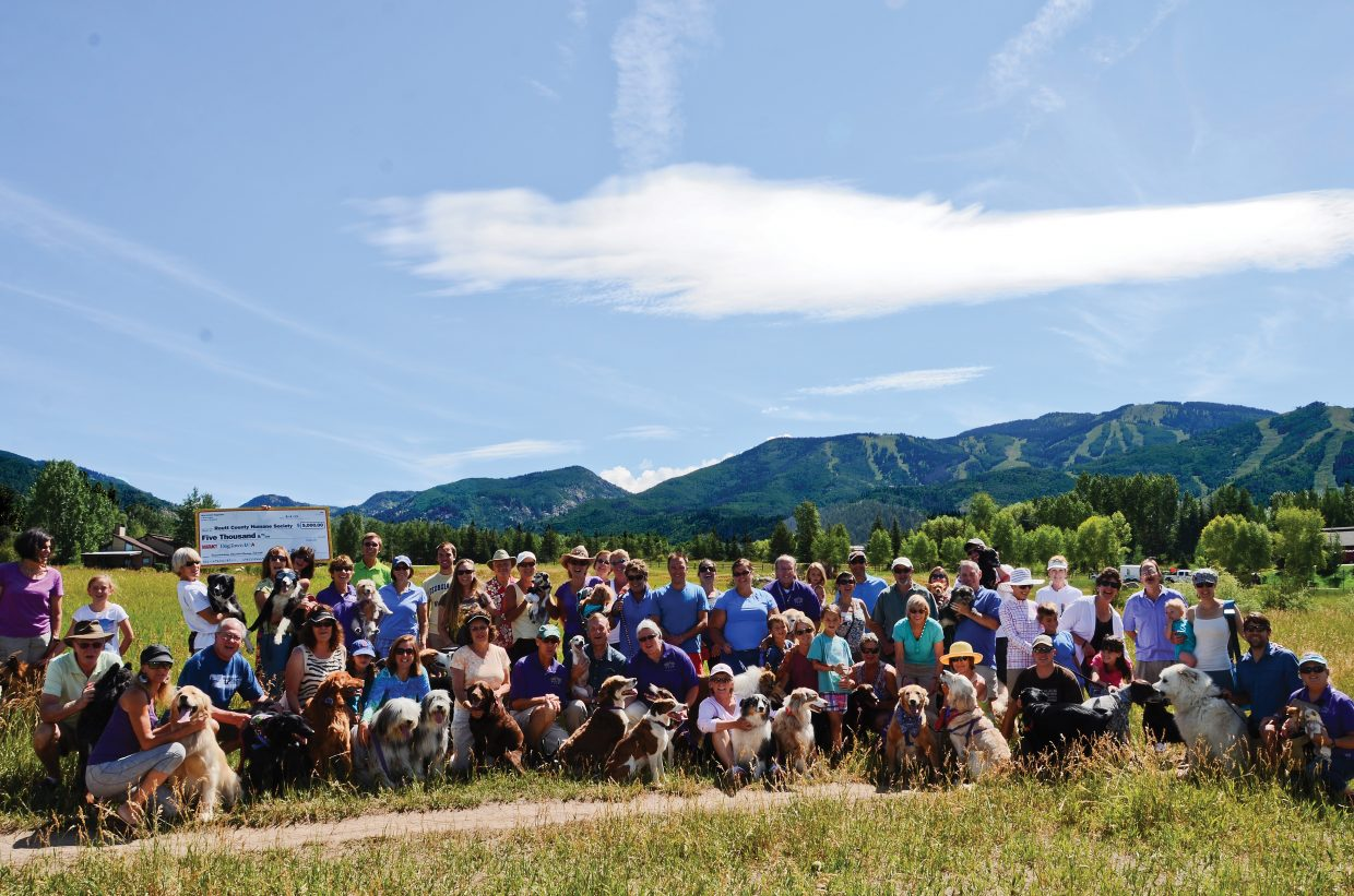 Dog lovers gathered Saturday at Rita Valentine Park to celebrate the announcement that Steamboat Springs was named Dog Town USA by Dog Fancy magazine. About 60 residents and their dogs attended the ceremony.