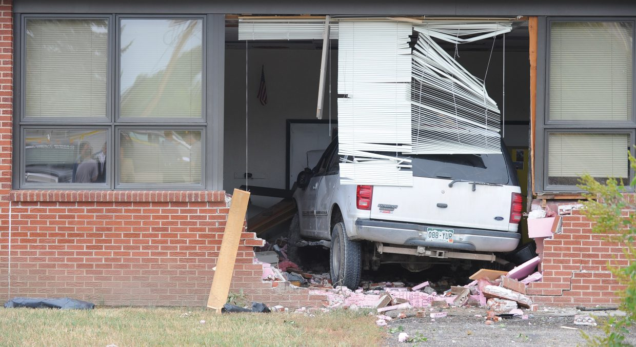 A Ford Expedition sits inside a classroom at Hayden Middle School on Tuesday afternoon after it hit several cars and then crashed through the brick wall. Investigators are asking anyone who witnessed the incidents to contact Sgt. Scott Elliott with the Colorado State Patrol at 970-879-0059 or police officer Jarrod Poley with the Hayden Police Department at 970-276-3232.
