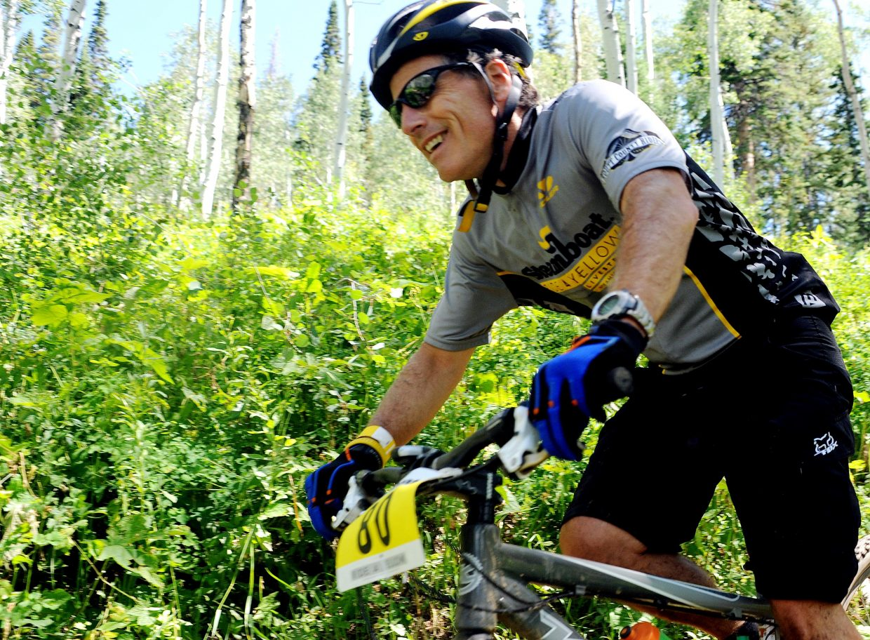 Eric Hirst rides in the second annual Ride 4 Yellow event in Steamboat Springs on Sunday. The cancer-fighting ride drew 116 riders, down from last year's 200, but it still raised about $150,000, half of which will go to local efforts.