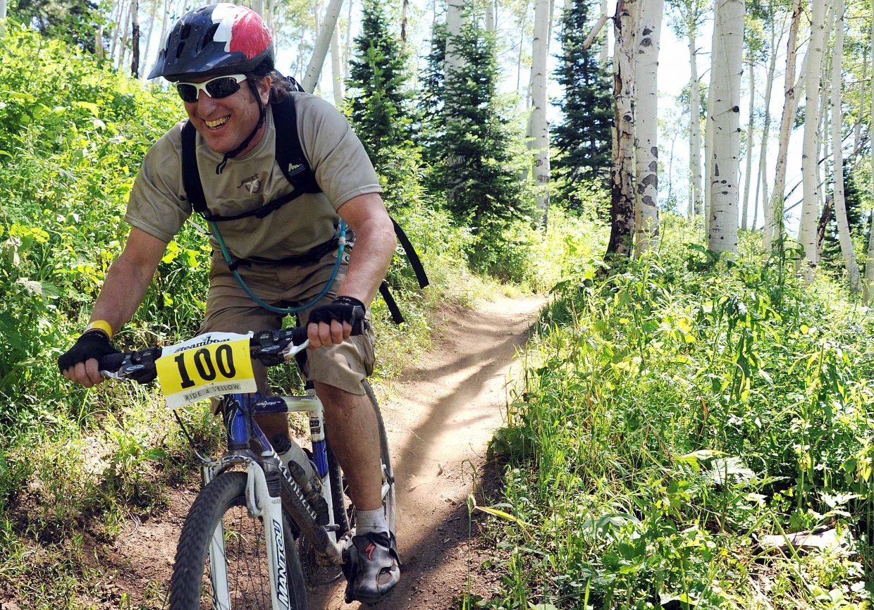 A cyclist rides in Sunday's Ride 4 Yellow event in Steamboat Springs.