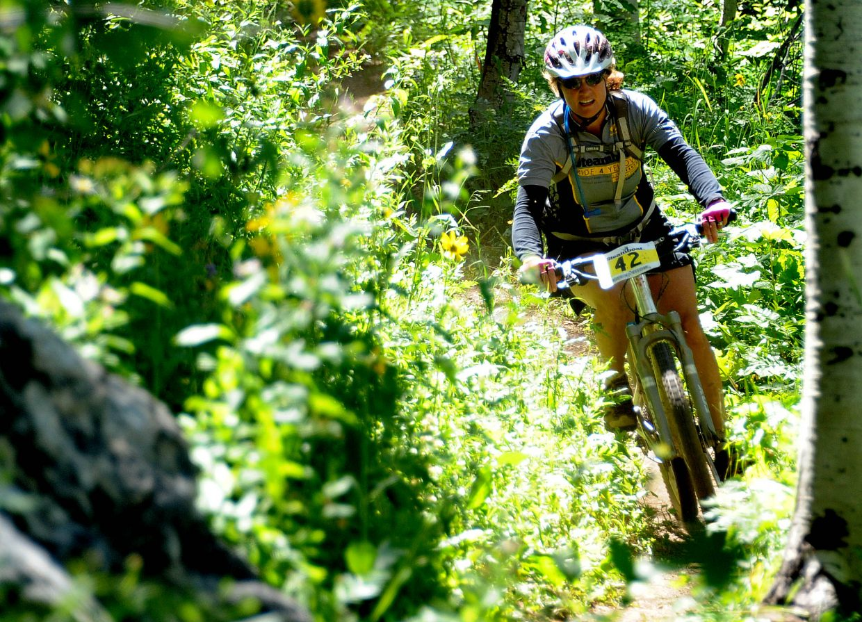 Kelly Becker cuts around a corner on the singletrack Sunday during the Ride 4 Yellow event in Steamboat Springs.
