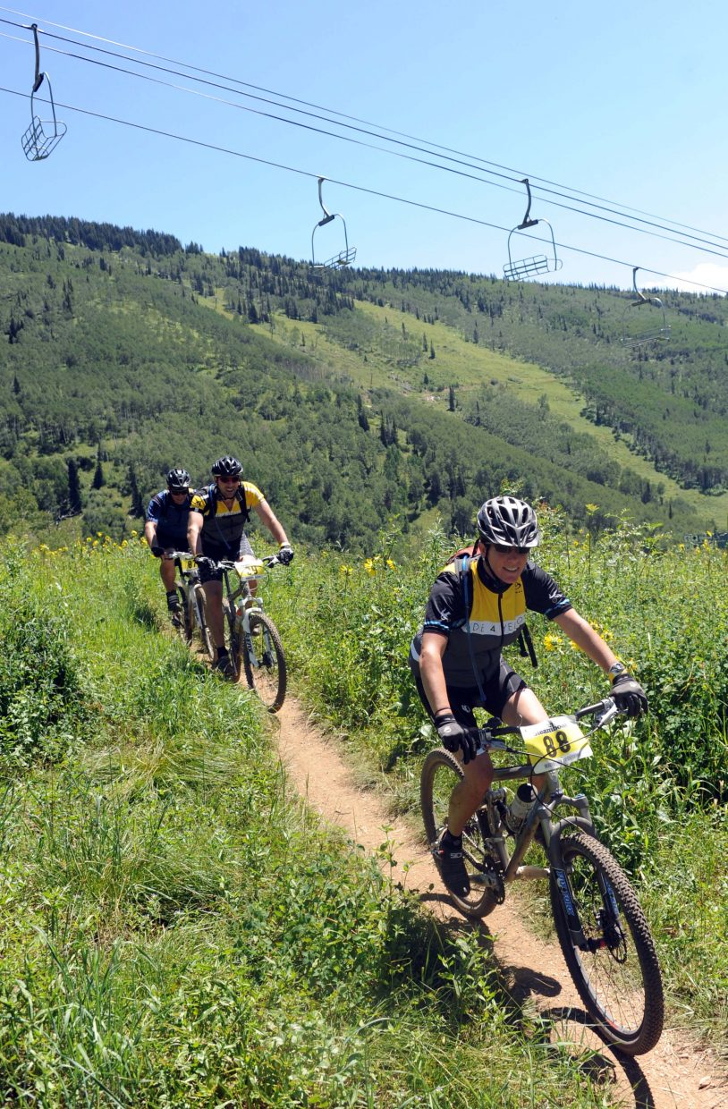 Beth Hagney leads a pack of riders Sunday during the Ride 4 Yellow event in Steamboat Springs.