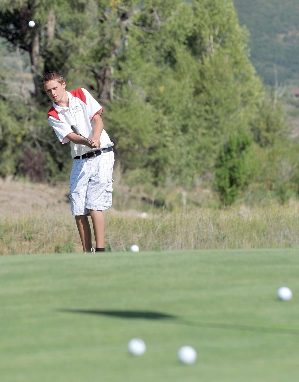 Steamboat Springs sophomore Brody King chips onto the practice green at Haymaker Golf Course on Tuesday during the high school golf team's skills challenge. The Sailors returned to practice Monday and will open the season Thursday.