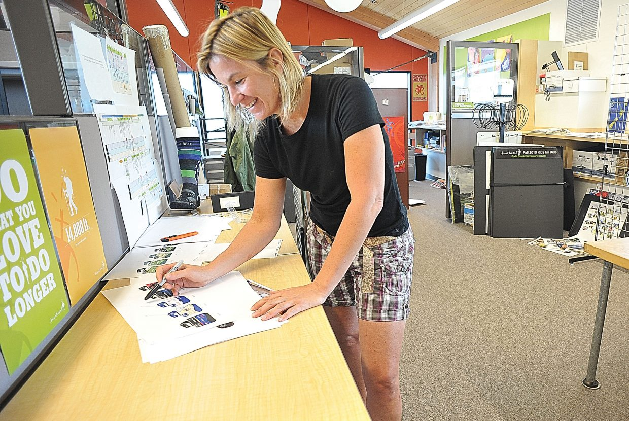 SmartWool employee Jenn Wilkinson was all smiles as she completed a task inside the SmartWool offices in Steamboat Springs on Tuesday afternoon. Steamboat Springs-based companies SmartWool and Boa Technology were listed among the top 100 places to work for by Outside magazine.