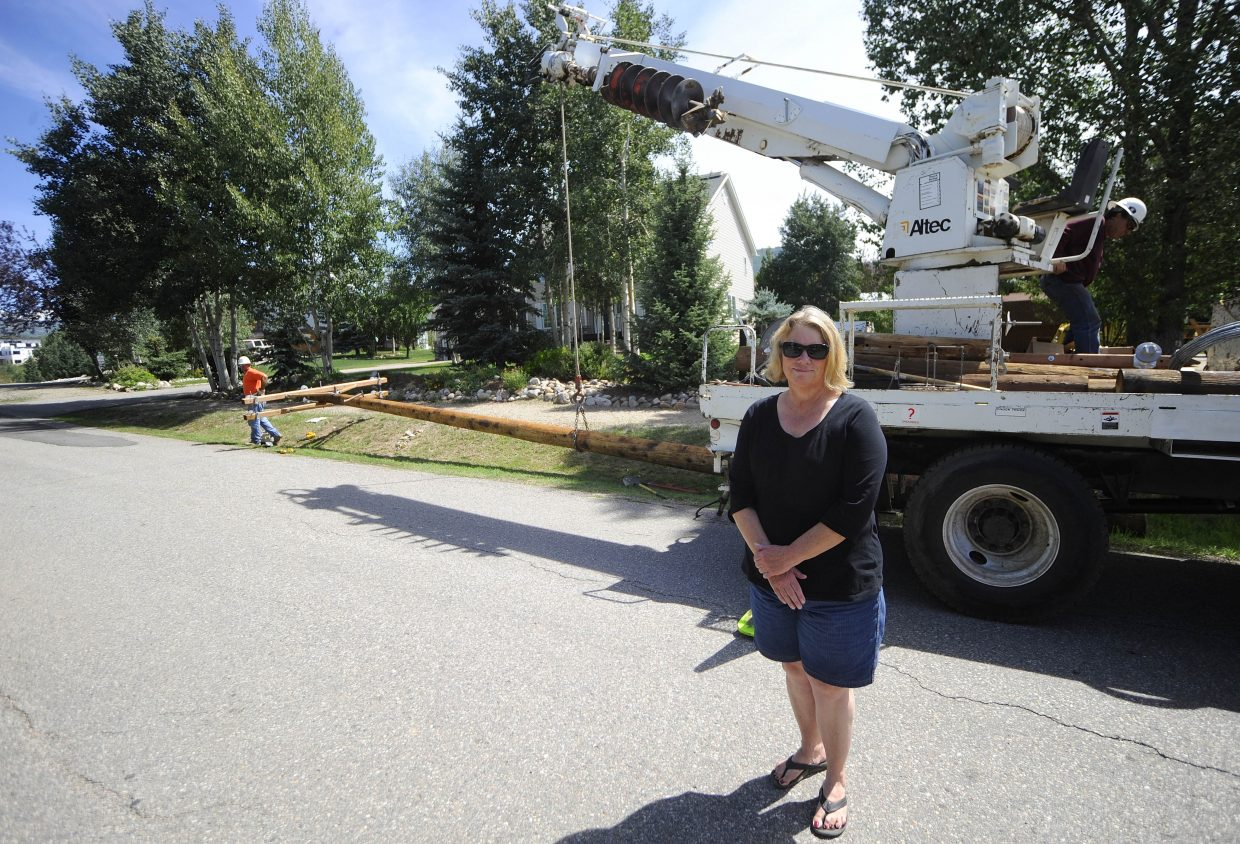 Steamboat Springs McKinley Street resident Debbie Metscher last week watched as new power lines were installed on her side of the street. She is upset the lines were not put underground.
