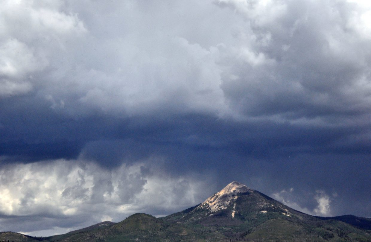 Storm clouds gather above Hahn's Peak in North Routt County.
