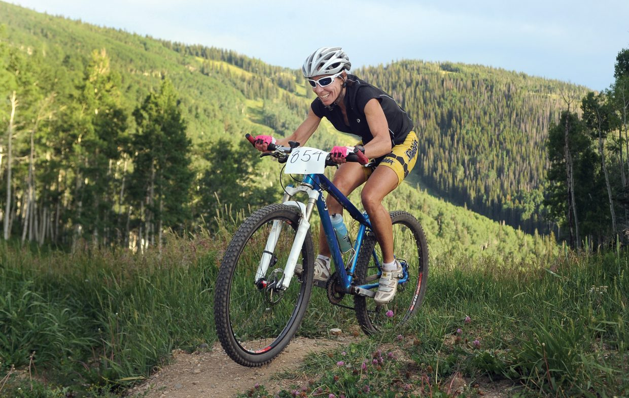 Tammy Jacques makes her way to the top of Storm Peak during Wednesday's Storm Peak Hill Climb mountain bike race. The event was the sixth race in the Town Challenge Mountain Bike Race Series.