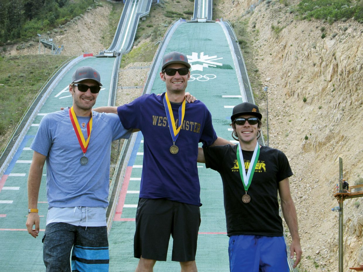 Bryan Fletcher stands atop the podium at the Springer Tournee Nordic Combined competition Saturday in Park City, Utah. Taylor Fletcher, left, placed second, and Brett Denney grabbed third.
