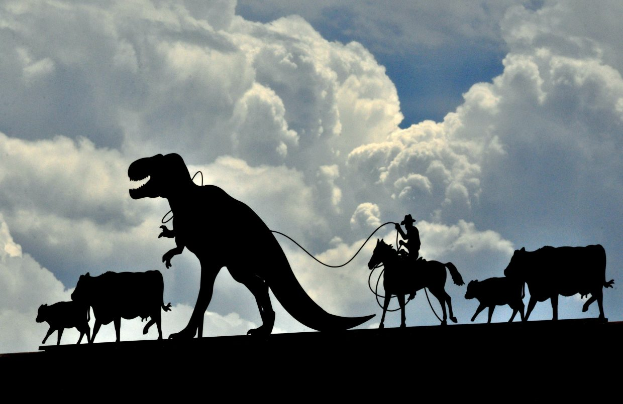 Closer to the town of Dinosaur, an iron cowboy tries to save his cattle from a T. rex.