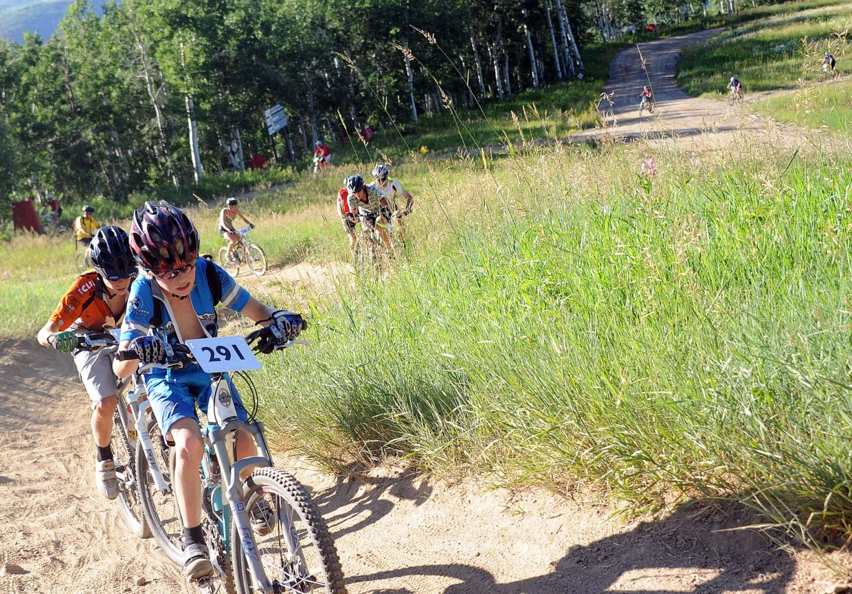 Jett Seymour leads a long chain of riders on Wednesday in the grueling Storm Peak Challenge mountain bike race at Steamboat Ski Area. The event sent riders on a grueling course with up to 3,000 feet of climbing.