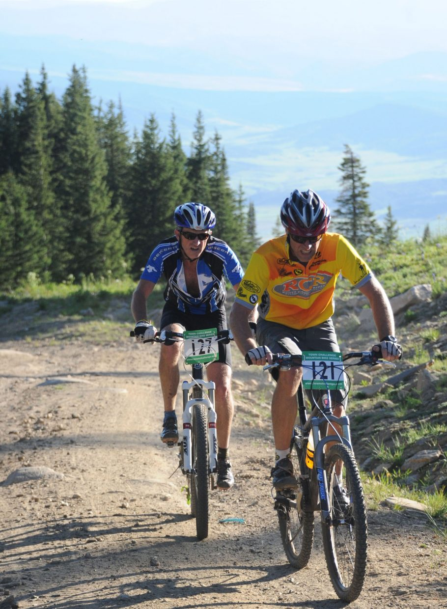 Rick Hodges, right, and PJ Wharton ride near the top of Storm Peak on Wednesday in a Town Challenge race in Steamboat Springs.