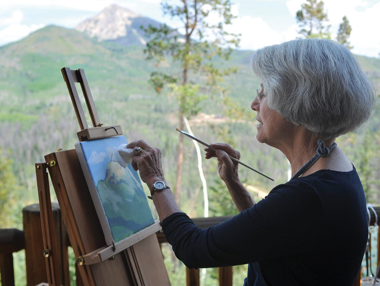 Artist Dedi Knox works on an oil painting on Hahn's Peak from the deck of her home in North Routt County. Knox is one of several artists that fine-tune their crafts in North Routt County.