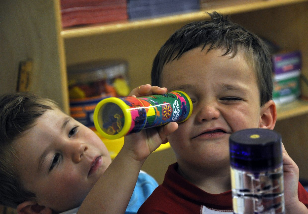 Hudson Merlina looks through a kaleidoscope being held up by his brother, Hayne, at the Discovery Learning Center in Steamboat Springs.