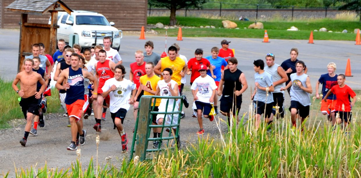 The Steamboat Springs High School football team raced to the top of Howelsen Hill on Friday as part of the annual event.