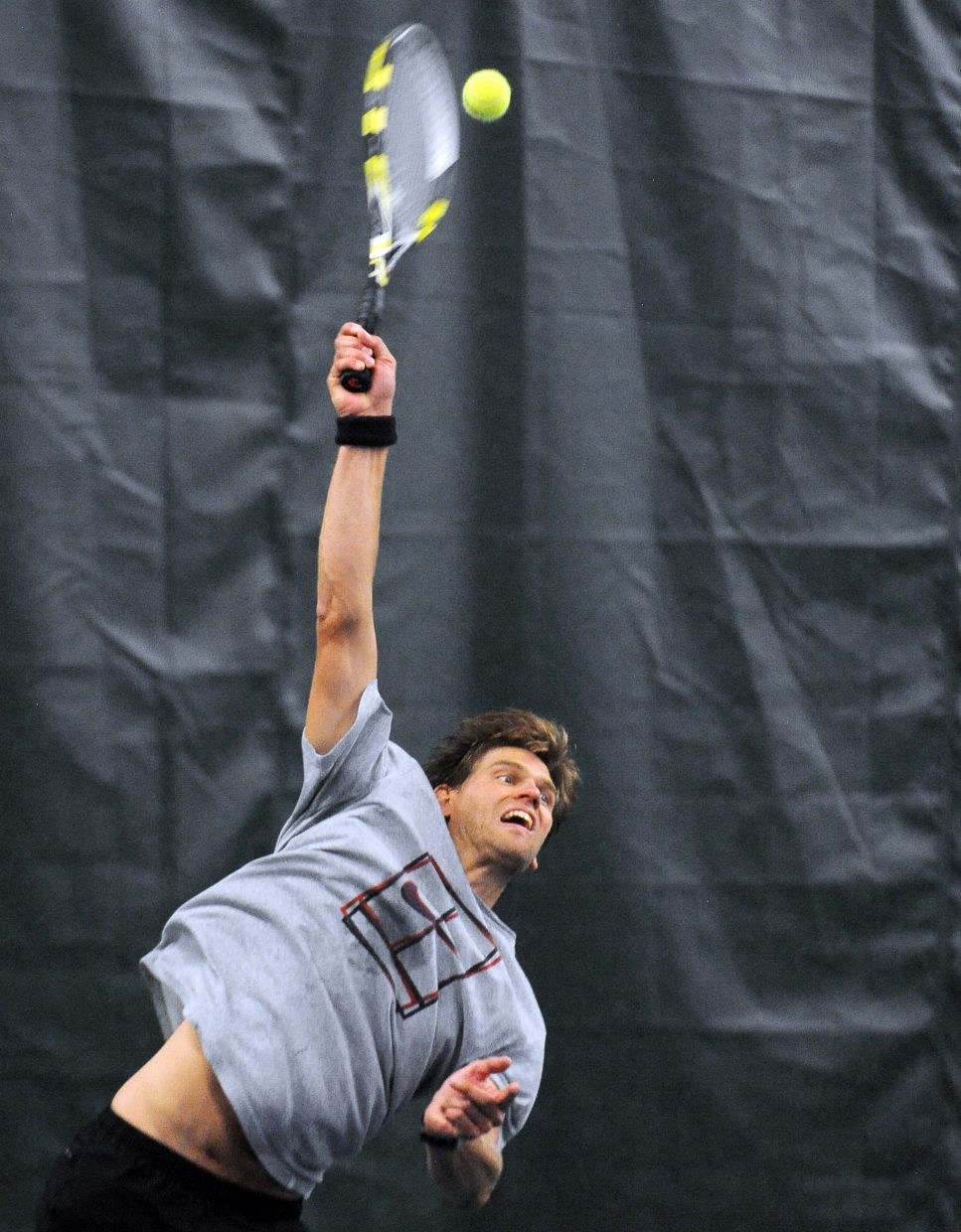 Louis Nijsten serves the ball Sunday during the Steamboat NTRP tournament at the Tennis Center in Steamboat Springs. Nijsten, of Hayden, partnered with Grice Hooker, of Steamboat, to win the top men's double bracket, prevailing in a grueling three-set match.