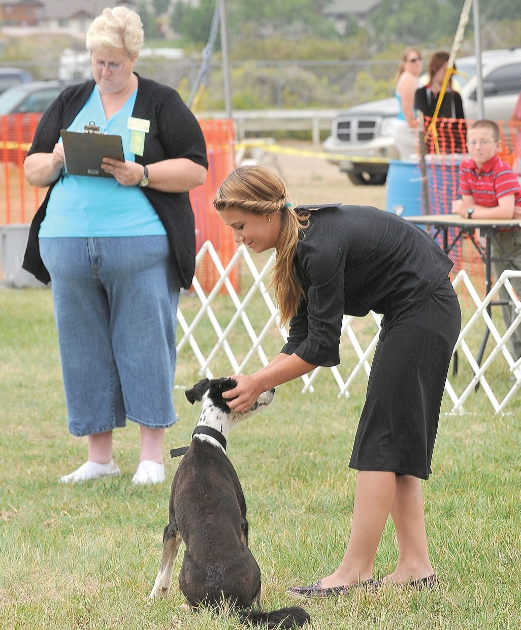 Jewel Vreeman scratches Selina behind the ears after completing an exercise at the Routt County Fair's dog show Monday morning. Eight competitors showed their dogs in a number of different classes at the dog show, which traditionally is one of the first events of the week at the annual fair.