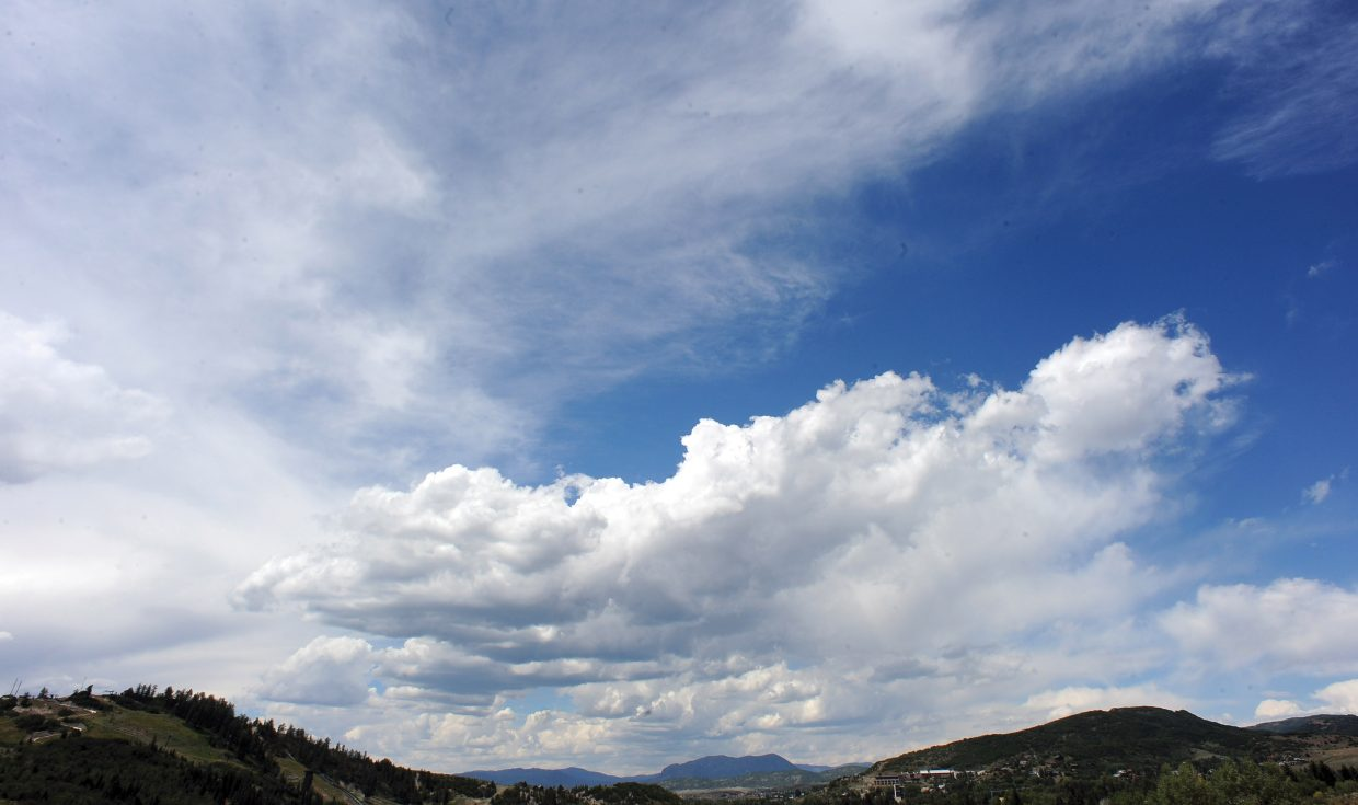 Clouds roll over Sleeping Giant, and downtown Steamboat Springs Monday afternoon.