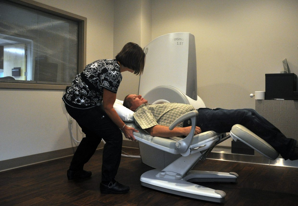 MRI technologist Janelle Buccino makes sure patient James Chapman is comfortable before his elbow is scanned in the new extremity MRI unit at Orthopedics of Steamboat Steamboat Springs.