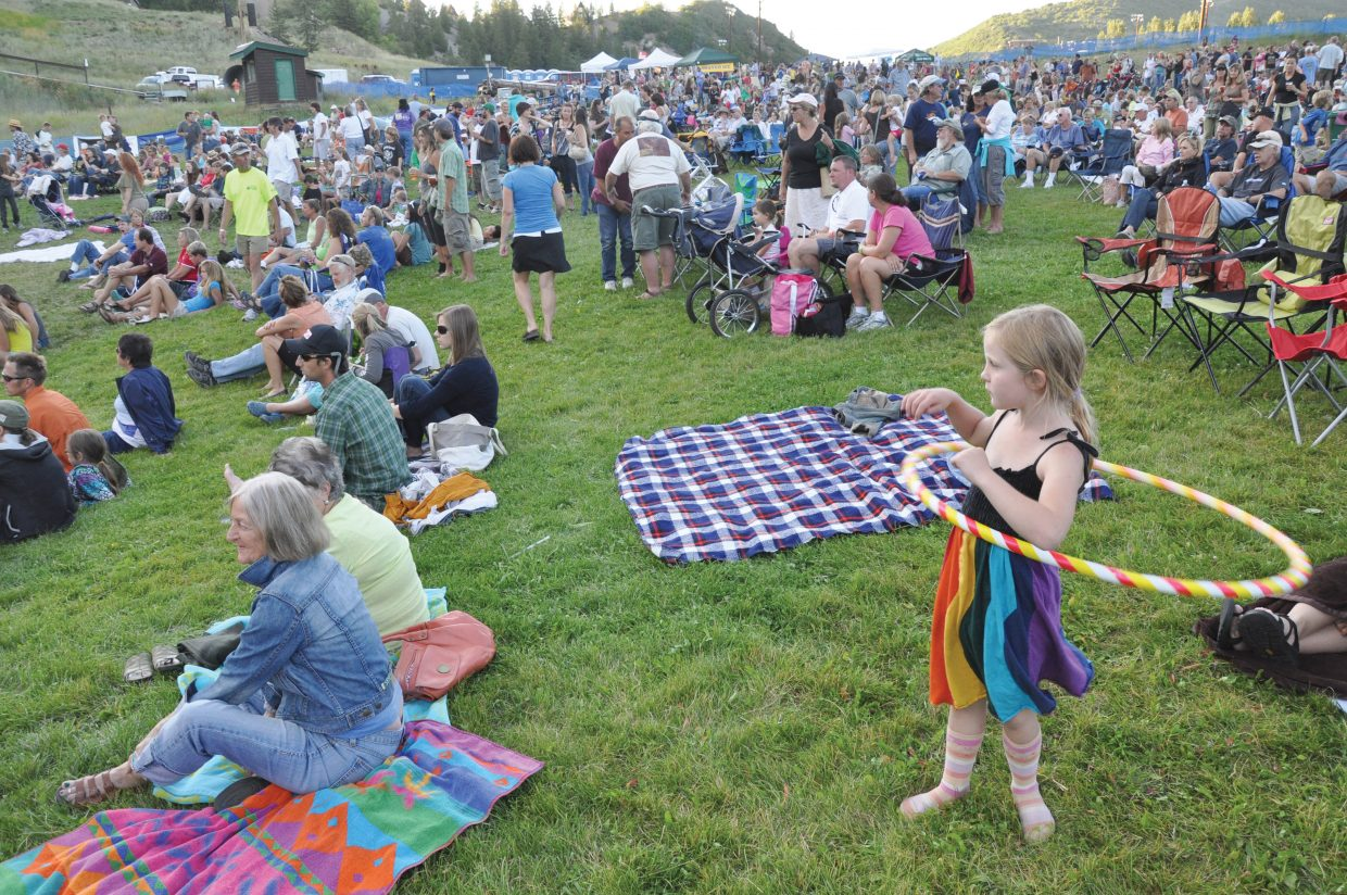 Arion Schweikert, 7, twirls a hula hoop as she watches the Free Summer Concert Series event at Howelsen Hill on Friday. JJ Grey performed with his blues band Mofro.